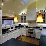 Kitchen Remodel - Custom cabinetry, plumbing, appliances, hood, counter, hardwood flooring