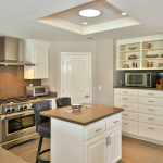 Custom kitchen with coffered lighting
