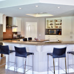 Breakfast bar surrounds kitchen